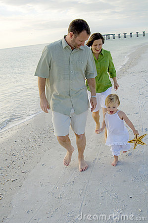 Active family playing on beach