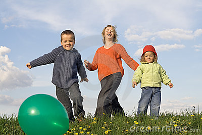 Active happy people outdoors - slight motion blur