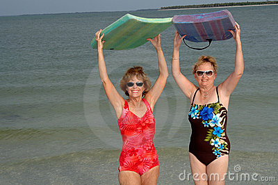 Active mature women at beach