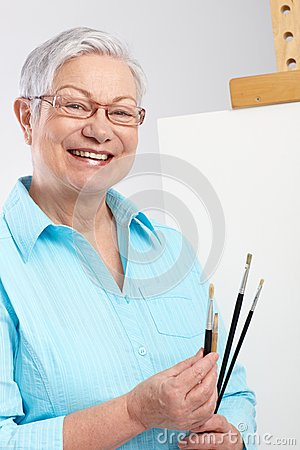 Active Pensioner With Paintbrush And Canvas Stock Images - Image: 25341004