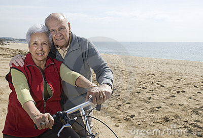 Active senior couple biking