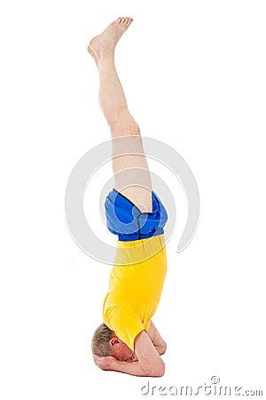 Active senior man. Stand on a head