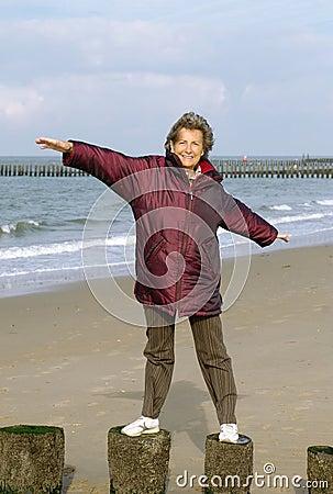 Active senior woman at the beach