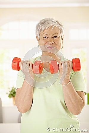 Active senior woman doing exercises