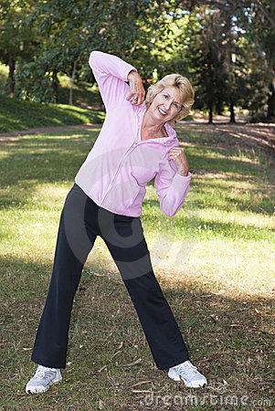 Active senior woman exercising in park