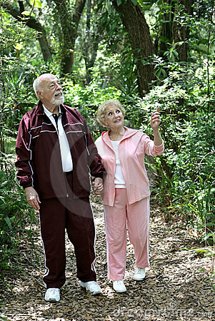 Free Active Seniors Walk In Woods Stock Images - 2428514
