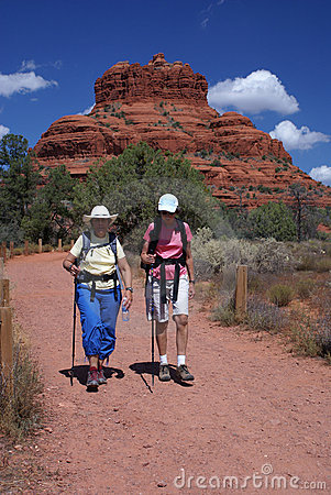 Active Seniors Walking on Mountain Trail