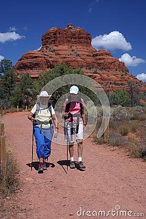 Active Seniors Walking on Mountain Trail