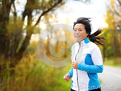 Active woman in her 50s running and jogging