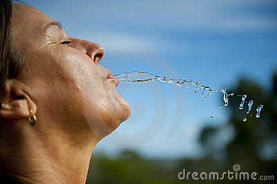Active Woman refreshing with water