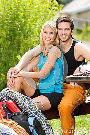Active young couple climbing gear relax terrace
