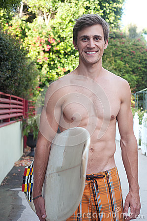 An active young man with a surfboard