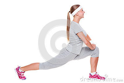 Active young woman doing stretching