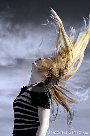 Active young woman with hair in motion