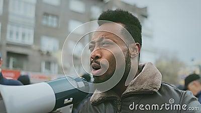 Activism megaphone shout. Loudspeaker activist scream. Strike protest revolt. African american man hold megaphone hand and shouting. Crowd people day stock video