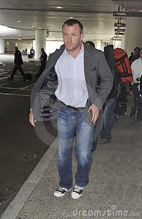 Actor/producer Guy Richie at LAX airport,CA USA Editorial Stock Photo