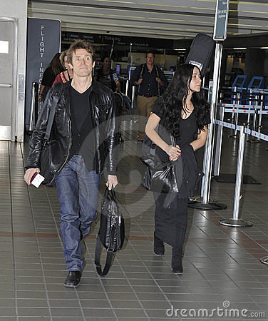 Actor Willem Dafoe with wife at LAX airport. Editorial Photo