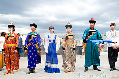 Actors in Russian and Buryat national costumes Editorial Photo