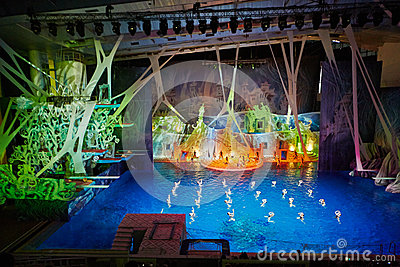Actors on stage and synchronized swimmers Editorial Image