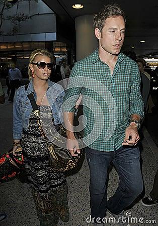 Free Actress Singer Jessica Simpson & Boyfriend At LAX Royalty Free Stock Photo - 16475585