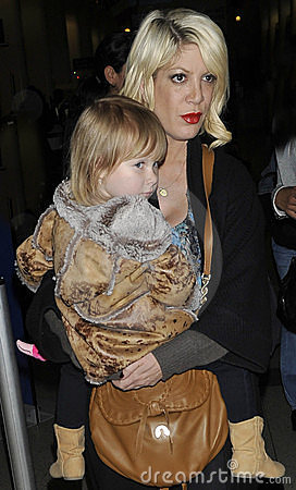 Actress Tori Spelling with daughter at LAX airport Editorial Photo