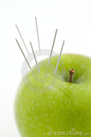 Acupuncture Needles In Apple Stock Photo - Image: 11550890