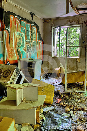 Adandoned trashed house with graffifi on walls