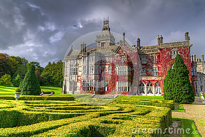 Adare castle in red ivy with gardens