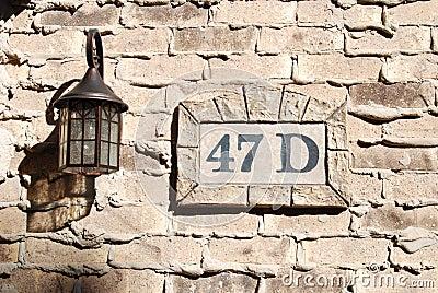 Address on Weeping Mortar Brick Wall