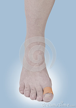 Adhesive Healing plaster on foot finger.