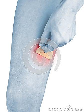 Adhesive Healing plaster on leg.