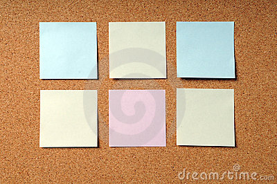 Adhesive Note Pads on Cork Board