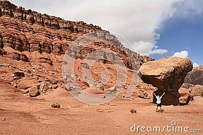 The admired tourist before a grandiose rock