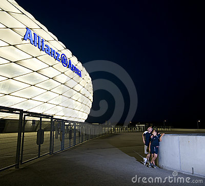 Admiring Allianz Arena at night Editorial Photo