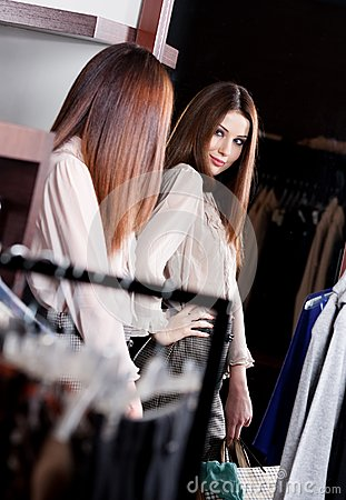 Admiring her beauty at the mirror in the store
