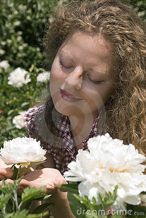 Admiring a peony flower