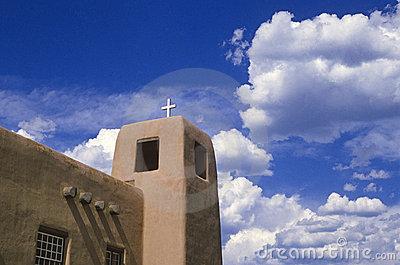 Adobe church and clouds