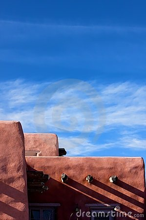 Free Adobe Structure Against A Bright Blue Sky Stock Image - 6295051