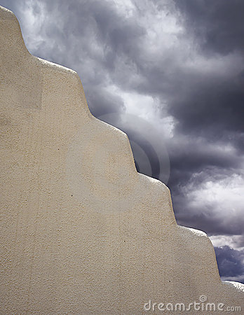 Free Adobe Wall With Storm Clouds Royalty Free Stock Photo - 21690405