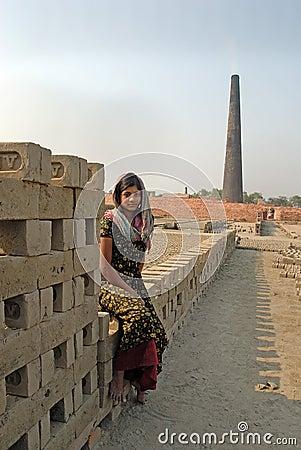 Adolescent girl in brick-field Editorial Photo