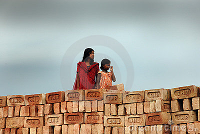 Adolescent girl in brick-field Editorial Image