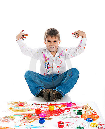 Adorable 3 year old boy covered in paint
