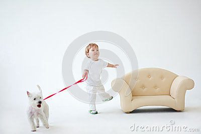 Adorable baby boy with dog
