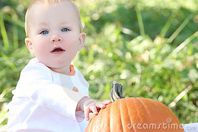 Adorable Baby Boy with Pumpkin