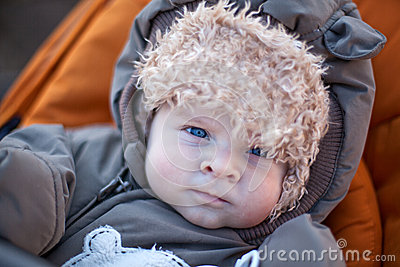 Adorable baby boy in winter clothes