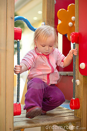 Adorable baby climb to baby slide on playground
