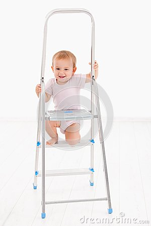 Free Adorable Baby Girl Climbing On Ladder Smiling Stock Images - 33471764