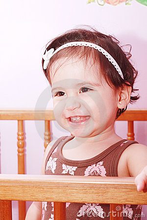 Adorable baby girl in nursery