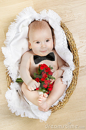 Free Adorable Baby Holding Flowers, Butterfly Tie Royalty Free Stock Photo - 23931675