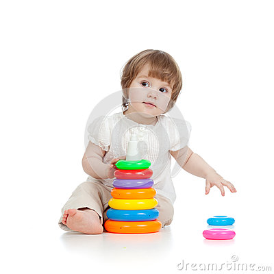 Adorable baby playing with colour toy